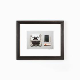 Typewriter art in black frame on white wall