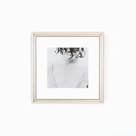 Black and White Photo of Woman in Silver Frame on White Wall