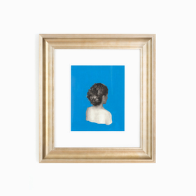 Art with woman in blue in champagne silver frame on white wall