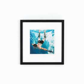 Man swimming art in black frame on white wall