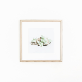 Geode art in silver frame on white wall