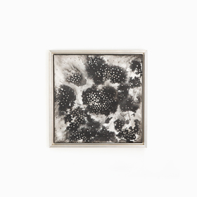 Black and white abstract art in silver canvas floater frame on white wall