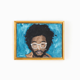 Man with glasses art in gold canvas floater frame on white wall