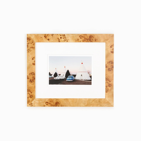 Teepee and car photo in burl wood frame on white wall