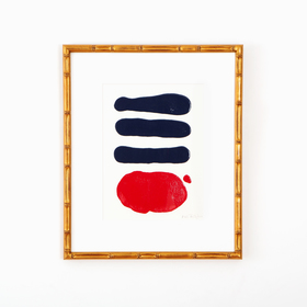Navy and red abstract art in gold bamboo frame on white wall