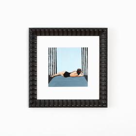 Woman in bathing suit art in wavy black frame on white wall