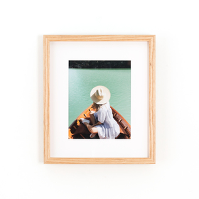 Ash wood framed photo of woman in boat on white background