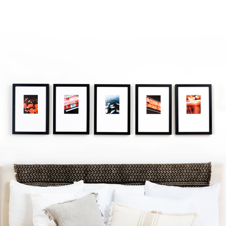 Over bed line gallery wall black