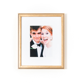 Rose gold copper frame with wedding couple.